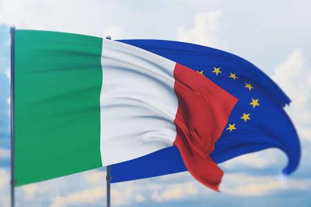 Waving European Union flag and flag of Italy. Closeup view, 3D illustration. Фото со стока