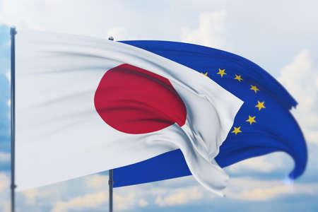 Waving European Union flag and flag of Japan. Closeup view, 3D illustration. Фото со стока