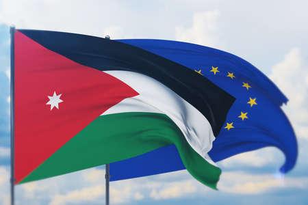 Waving European Union flag and flag of Jordan. Closeup view, 3D illustration.