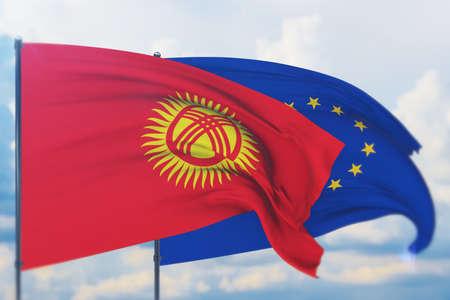 Waving European Union flag and flag of Kyrgyzstan. Closeup view, 3D illustration. Фото со стока