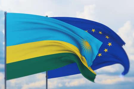 Waving European Union flag and flag of Rwanda. Closeup view, 3D illustration.