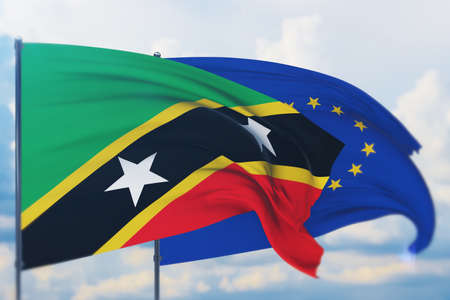 Waving European Union flag and flag of Saint Kitts and Nevis. Closeup view, 3D illustration.