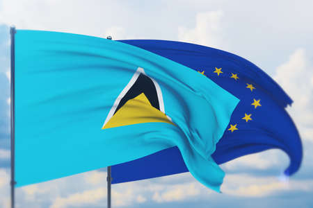 Waving European Union flag and flag of St. Lucia. Closeup view, 3D illustration.