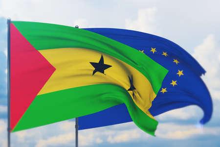 Waving European Union flag and flag of Sao Tome and Principe. Closeup view, 3D illustration. Фото со стока