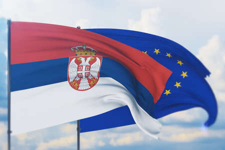 Waving European Union flag and flag of Serbia. Closeup view, 3D illustration.