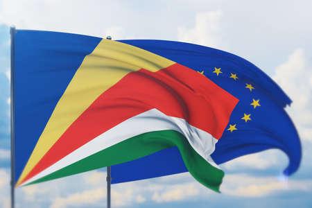 Waving European Union flag and flag of Seychelles. Closeup view, 3D illustration.