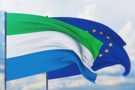 Waving European Union flag and flag of Sierra Leone. Closeup view, 3D illustration. Фото со стока