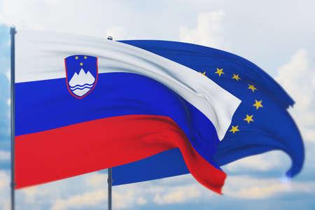 Waving European Union flag and flag of Slovenia. Closeup view, 3D illustration.
