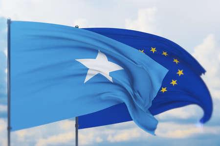 Waving European Union flag and flag of Somalia. Closeup view, 3D illustration.