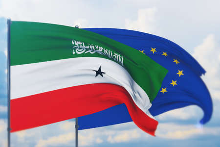 Waving European Union flag and flag of Somaliland. Closeup view, 3D illustration. Фото со стока