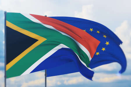 Waving European Union flag and flag of South Africa. Closeup view, 3D illustration. Фото со стока