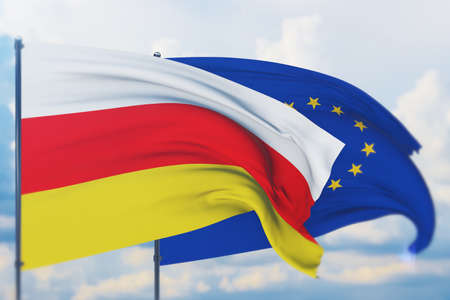 Waving European Union flag and flag of South Ossetia. Closeup view, 3D illustration.