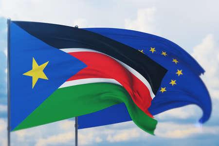 Waving European Union flag and flag of South Sudan. Closeup view, 3D illustration.