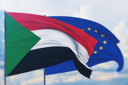 Waving European Union flag and flag of Sudan. Closeup view, 3D illustration.
