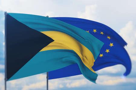 Waving European Union flag and flag of Bahamas. Closeup view, 3D illustration.