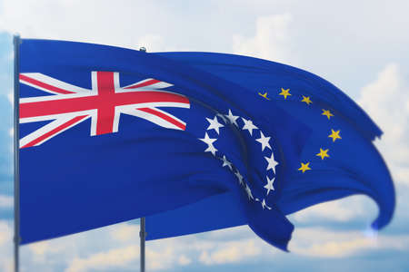 Waving European Union flag and flag of Cook Islands. Closeup view, 3D illustration. Фото со стока