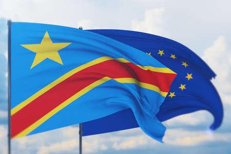 Waving European Union flag and flag of Democratic Republic of the Congo. Closeup view, 3D illustration.