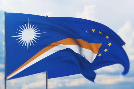 Waving European Union flag and flag of Marshall Islands. Closeup view, 3D illustration. Фото со стока