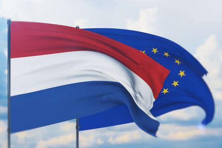 Waving European Union flag and flag of Netherlands. Closeup view, 3D illustration. Фото со стока