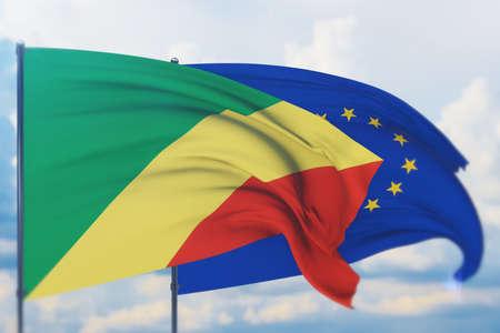 Waving European Union flag and flag of Republic of the Congo. Closeup view, 3D illustration. Фото со стока