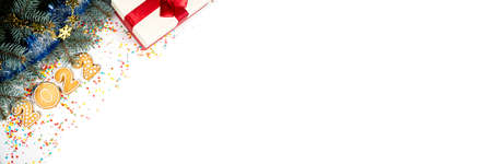 Christmas white banner with gingerbread 2022 on snow. Holiday mood card. Top view, copy space.