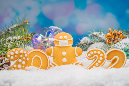 Christmas background with gingerbread 2022. Holiday mood card. Family traditions, DIY, celebration concept. Festive background with homemade gingerbread cookies.