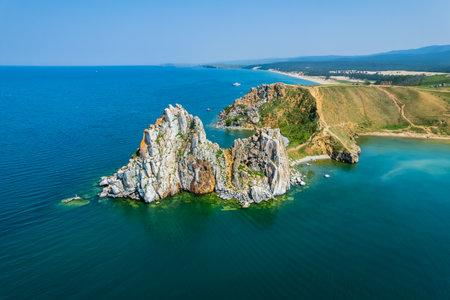 Olkhon Island, the largest island in Lake Baikal in eastern Siberia. Shamanka Rock on Baikal lake near Khuzhir at Olkhon island in Siberia, Russia.