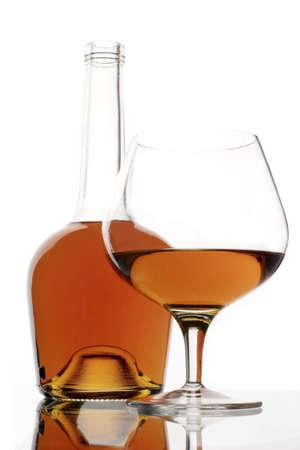 wino: brandy glass and bottle