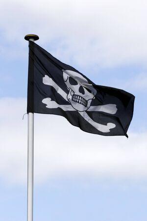 treacherous: flag skull and cross bones Stock Photo