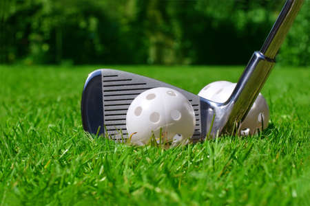 friendly competition: practise golf ball and club