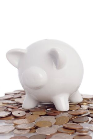 overdraft: piggy bank on top of a pile of coins