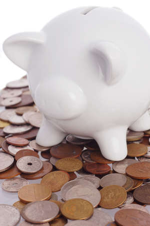 overdraft: piggy bank on top of a pile of assorted  world coins