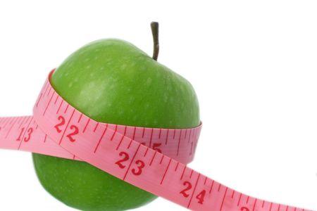 disorders: cinta m�trica y manzana, el comer sano Foto de archivo
