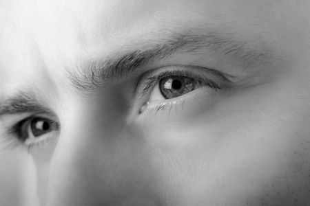 deep in thought: male eyes closeup Stock Photo
