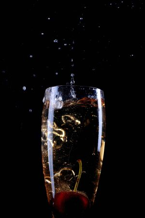 the carbonation: cherry dropping into champagne