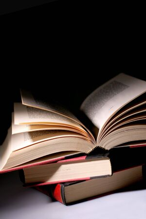 night school: pile of books, dim lighting for effect Stock Photo
