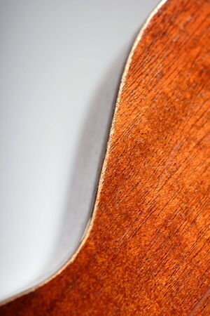 ukulele, string instrument showing curve of wood photo