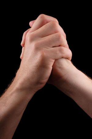handclasp: clasped hands in position of success
