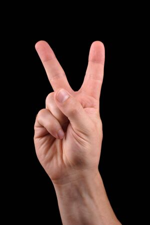 victory sign: hand in peace sign
