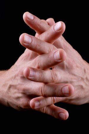 mans hands linked together photo