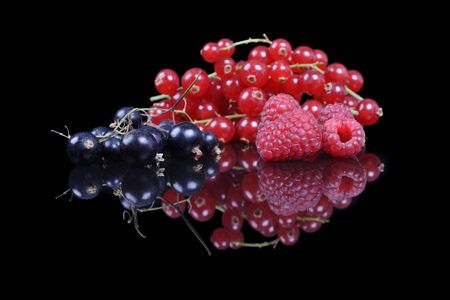 currants: mixed berries and currants on a black reflective background