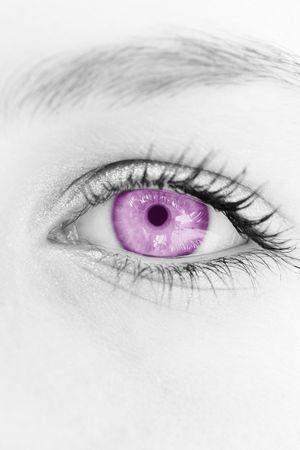 hypnotise: selective magenta coloring of a females  eye. Stock Photo