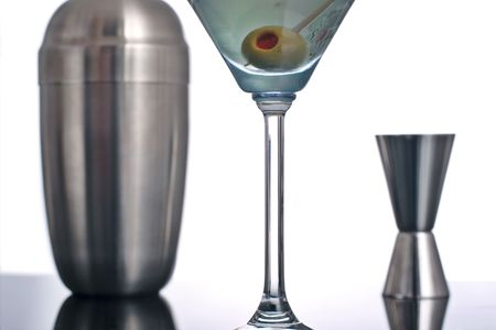 martini shaker: martini cocktail with stuffed olive,cocktail mixer and shaker