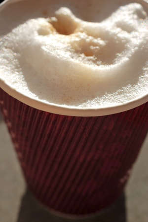 frothy: frothy coffee in disposable cup,recycle. Stock Photo