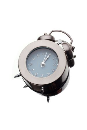 nearly: silver alarm clock with time nearly reaching midnight, midday.Impression of falling