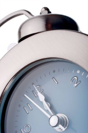 midday: silver alarm clock with time nearly reaching midnight, midday