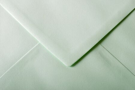 written communication: green envelope with textured paper Stock Photo