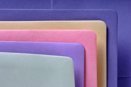 written communication: various colored envelopes with textured paper