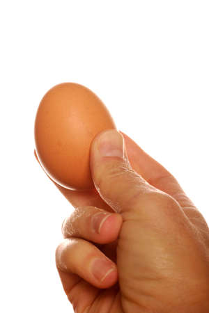 chucky: hand  and hens egg, to give.