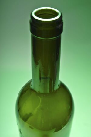 opened bottle of red wine on green ambient background Stock Photo - 719381